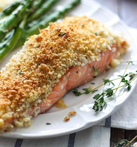 Parmesan crusted salmon plated with asparagus